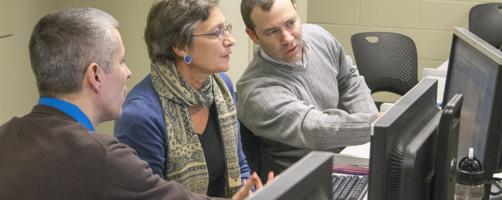 Staff and faculty members discussing web tools